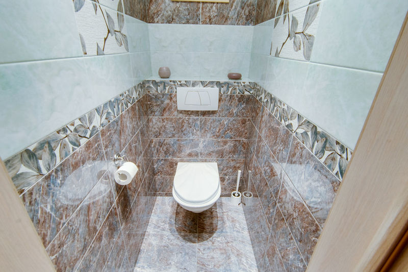 Bathroom Indoors  Domestic Bathroom High Angle View Toilet Home Flooring Domestic Room Architecture No People Tile Bathtub Modern Home Interior Absence Toilet Bowl Railing Sink Faucet Built Structure Luxury Tiled Floor