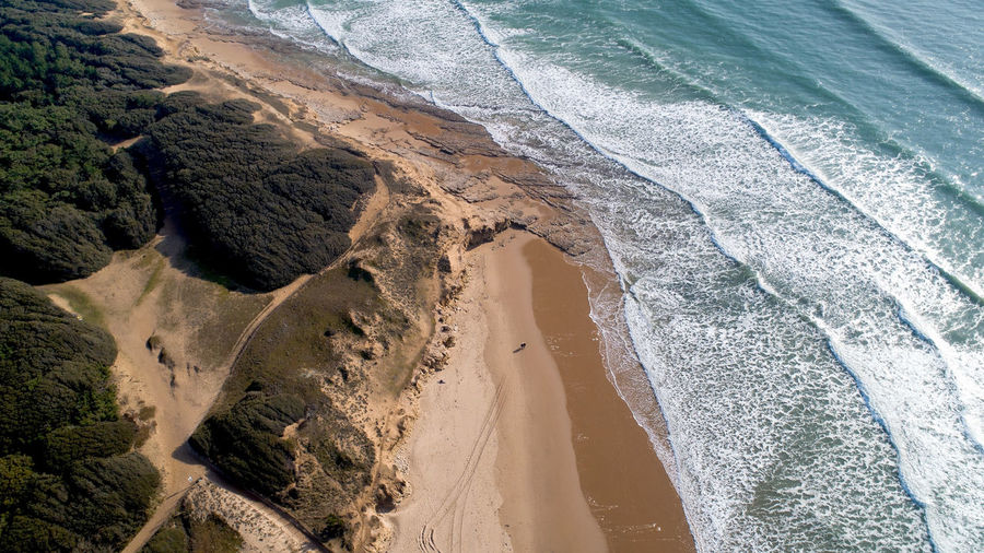 Aerial photography of two people hiking on a beach in Vendée, France Jard Sur Mer Vendée France Atlantic Ocean Sea Land Water Beach Scenics - Nature Beauty In Nature Sand Tranquility High Angle View Motion Wave Outdoors People Walking Hiking Aerial View Aerial Photography Above