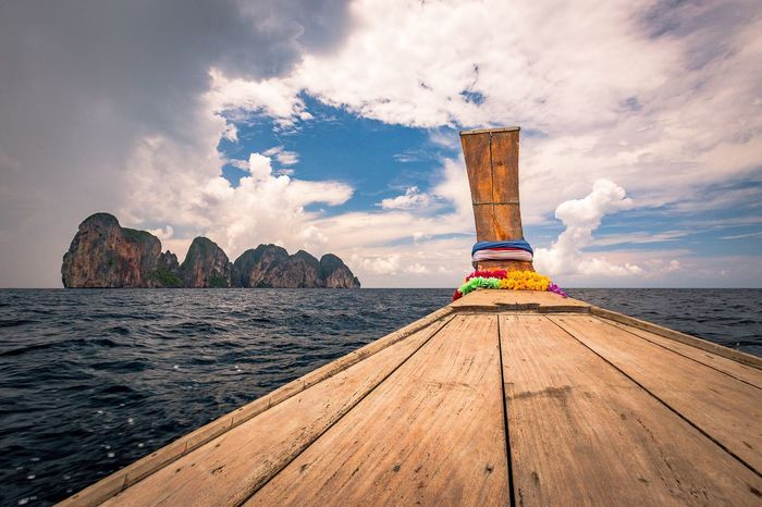 some of my best moments in 2017 Adventure Transportation Wonderlust Travelfuntime Adaman Sea Longtail Boat Adventure Explore Travel FollowMeOnInstagram Leading Lines Landscape Copy Space Exotic Phiphiisland Thailand Tranquil Scene Tranquility Tropical Climate Tropical Paradise Vacations Holiday Sky Wood - Material Scenics No People Beauty In Nature Outdoors Horizon Over Water Day