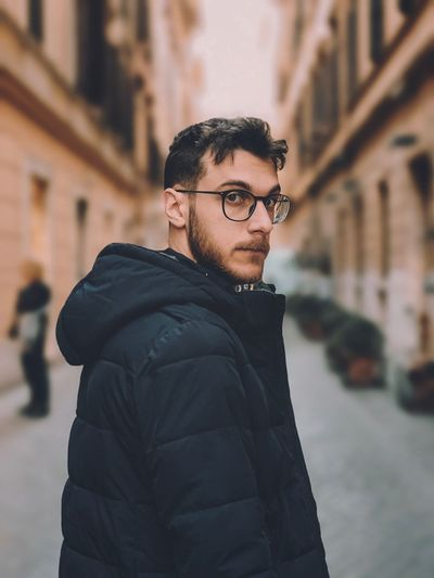 My man EyeEm Selects One Person Young Adult Glasses Eyeglasses  Focus On Foreground Architecture Real People Standing Beard Outdoors Portrait Looking At Camera Men City