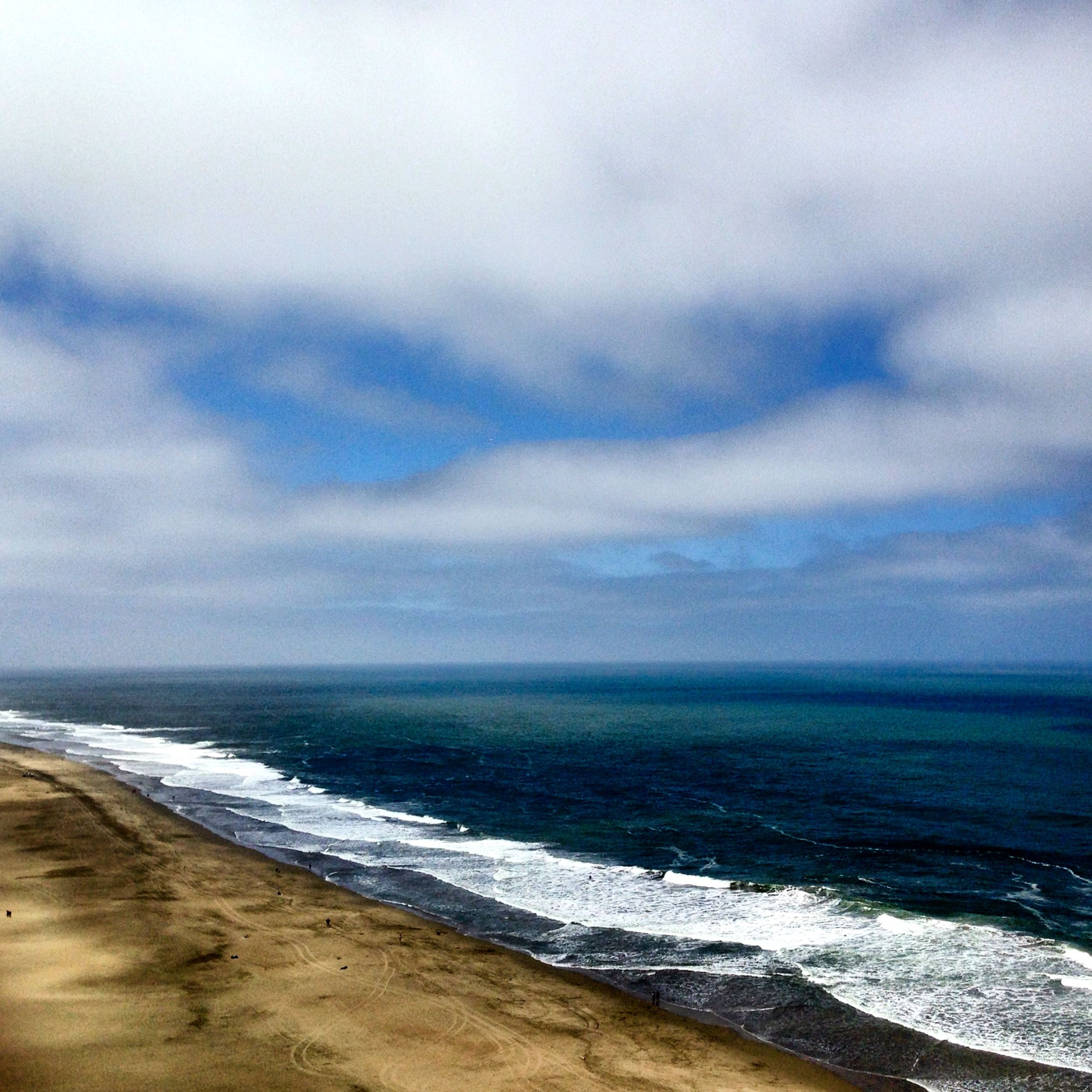 sea, beach, horizon over water, sky, water, scenics, shore, tranquil scene, tranquility, beauty in nature, cloud - sky, cloudy, nature, wave, sand, weather, idyllic, overcast, surf, cloud