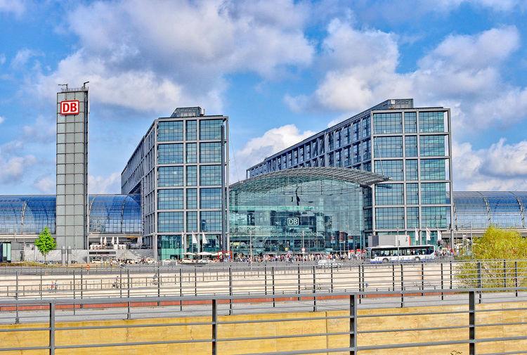 Street By Berlin Hauptbahnhof Against Cloudy Sky