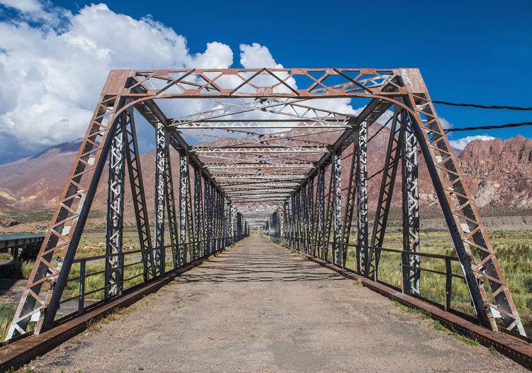 Footbridge against sky