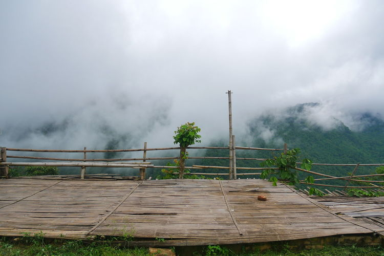 Air Pollution Architecture Beauty In Nature Built Structure Cloud - Sky Day Environment Fog Grass Landscape Nature No People Outdoors Plant Power In Nature Railing Sky Smoke - Physical Structure Tranquil Scene Water Wood - Material