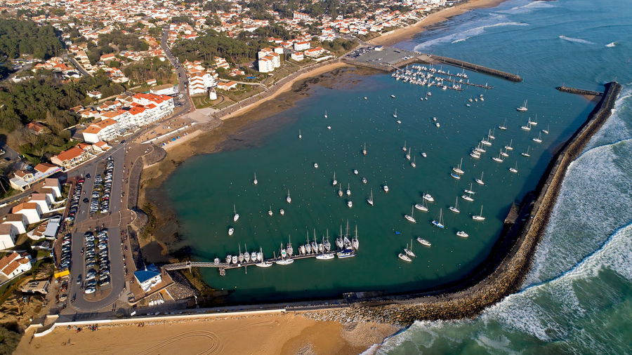 Aerial photo of Jard sur Mer port in Vendée, France Jard Sur Mer Vendée France French Europe Port Marina Bay Sea Beach Water Atlantic Ocean Coast Coastline Seawall Aerial View Transportation Nautical Vessel Boat Sailboat Sailing Ship Aerial Photography Travel Destinations Travel Turquoise Colored Outdoors Day High Angle View