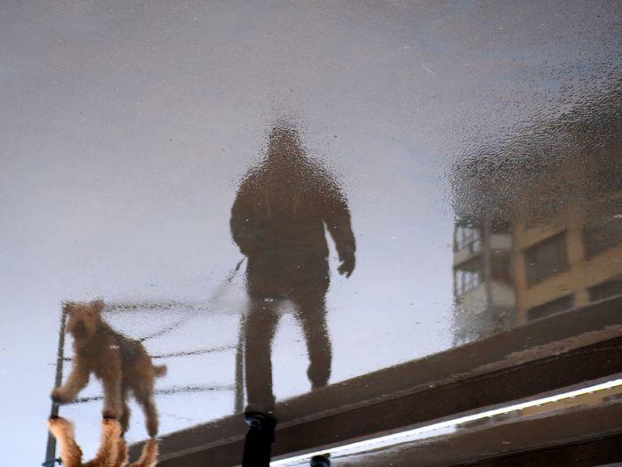 Full length of man on snow during rainy season