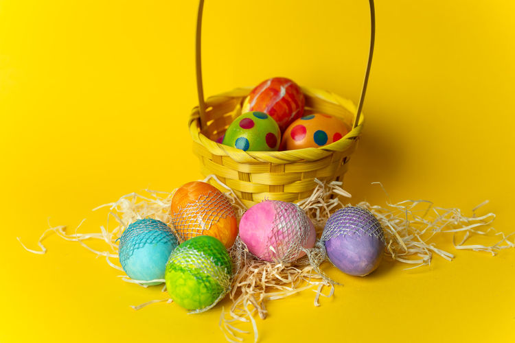 Easter time Spring Springtime Easter Egg Colorful Colors Easter Yellow Candy Celebration Easter Egg Multi Colored Close-up Animal Egg Yellow Background Egg Nest Eggshell Nest Egg Boiled Egg