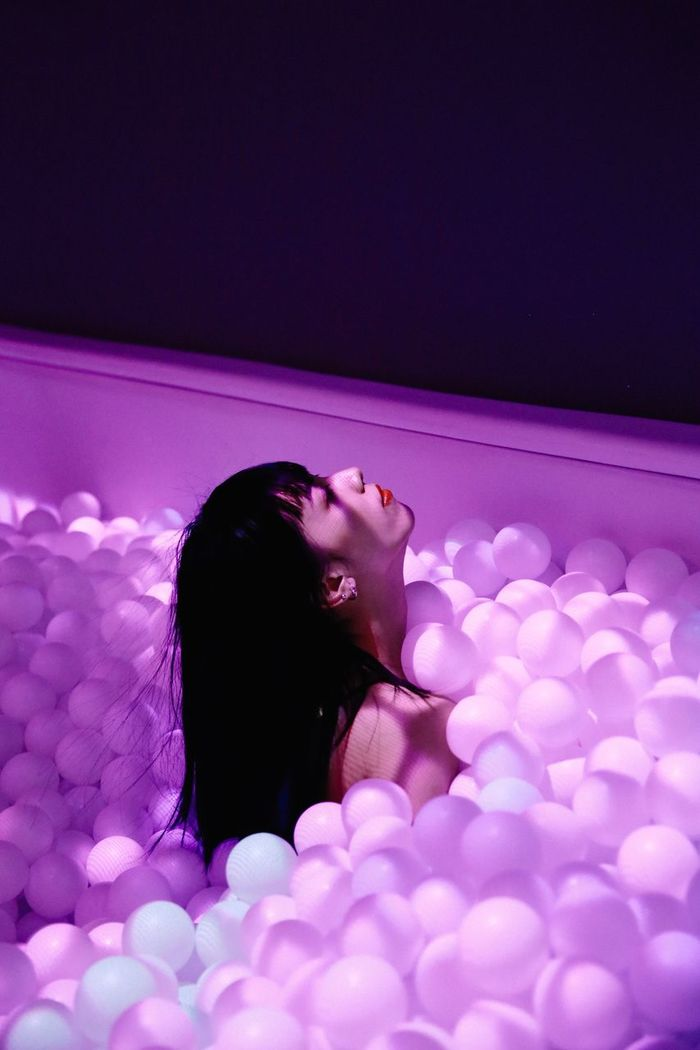 WOMAN RELAXING IN ILLUMINATED PINK