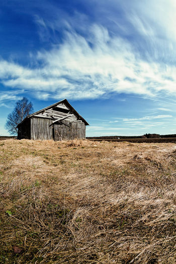 Springtime Clouds Over The Fields Finland Rural Scandinavia Abandoned Agricultural Building Architecture Building Building Exterior Built Structure Cabin Cloud - Sky Day Environment Field Grass House Land Landscape Nature No People Outdoors Plant Scenics - Nature Sky Tranquility