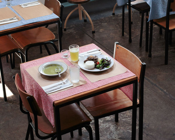 Breakfast Chair Day Dining Table Drink Drinking Glass Food Food And Drink Freshness Furniture Healthy Eating High Angle View Indoors  Napkin No People Place Setting Plate Ready-to-eat Restaurant Serving Size Table Tablecloth Wood - Material