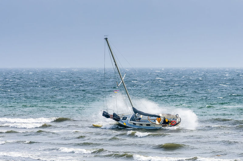 Ship in Distress Blue Boat Day Floundering Horizon Over Water Idyllic Mode Of Transport Motion Nature Nautical Vessel No People Non-urban Scene Outdoors Remote Rippled Sailing Scenics Sea Seascape Ship Wreck Sky Tranquil Scene Transportation Water Wave