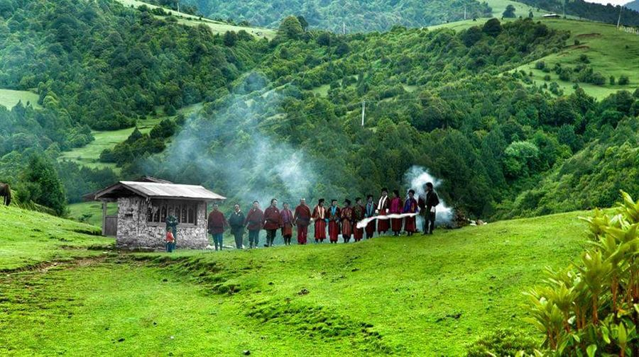 These are the people of sakten bidding us farewell ... they sing and wave goodbyes with their white scarfs fluttering in the air till we are out of sight.. LifeInSakten highlanders Nomads Nomadiclife Real People Tree Lifestyles Men Nature Growth Green Color Outdoors Tea Crop Beauty In Nature Large Group Of People Day Uniqueness EyeEmNewHere