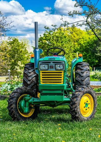 Field Green Color Retro Sky And Clouds Trees Clouds And Sky Day Field Grass Green Color Growth Land Vehicle No People Old Oldtimer Outdoors Sky Stationary Tractor Transportation Tree Yellow