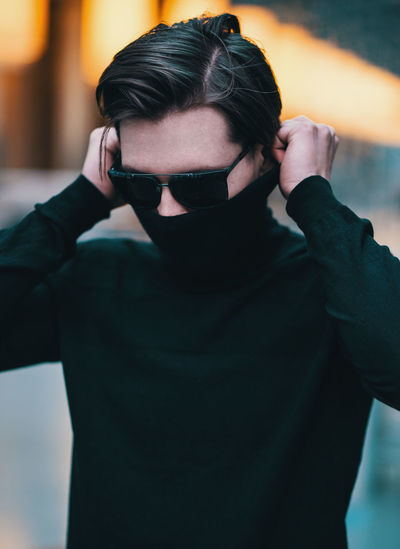One Person Front View Real People Young Adult Leisure Activity Lifestyles Casual Clothing Portrait Young Men Focus On Foreground Standing Waist Up Indoors  Technology Fashion Photographing Sunglasses Glasses Looking At Camera