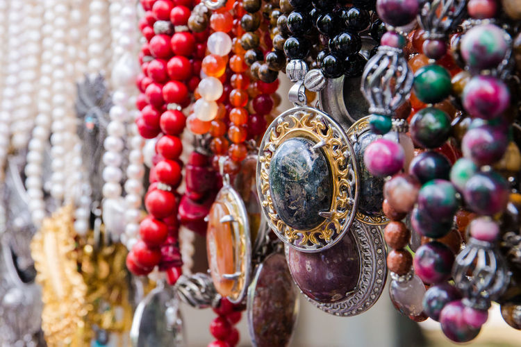 colorful beads Abundance Art And Craft Bead Choice Close-up Craft Creativity Focus On Foreground For Sale Hanging Jewelry Large Group Of Objects Market Multi Colored Necklace No People Pearl Jewelry Personal Accessory Retail  Retail Display Sale Variation