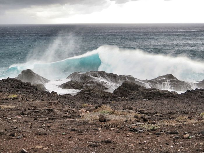 View of waves breaking at shore