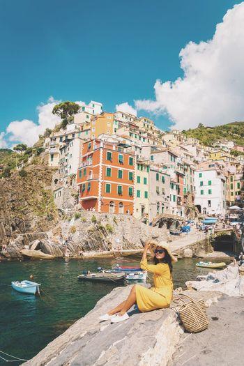 Woman Riomaggiore Cinque Terre Cinque Terre Girl Dress Cinqueterre Liguria Liguria,Italy Liguria, Italy Italy Vacations EyeEm Selects Sitting Water City Beach Sky Architecture Tide Coast Settlement