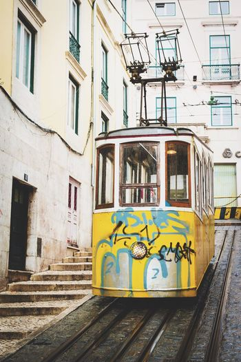 Cable Car On Street Against Building In City