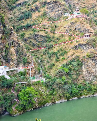 Nature High Angle View Outdoors Day No People Growth Green Color Beauty In Nature Tranquility Grass Scenics Water Himachal Pradesh, India EyeEm Selects Streetphotography Multi Colored India Pine Tree Mountain Kullu Arts Culture And Entertainment Traditional Temple Sprituality