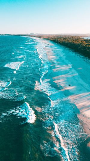 Golden hour Dji Beach Australia Queensland Blue DJI Mavic Pro Golden Hour Water Sea Beauty In Nature Sky Scenics - Nature Tranquility Nature Clear Sky Day Blue Motion Waterfront Horizon Land No People Outdoors Beach Horizon Over Water Wave Tranquil Scene