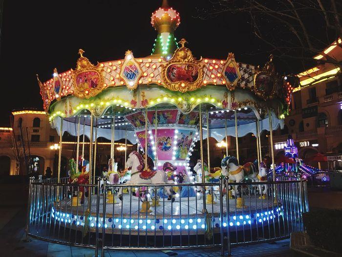 Colors Illuminated Night Carousel Architecture Amusement Park Decoration Lighting Equipment Amusement Park Ride Built Structure Holiday City Outdoors