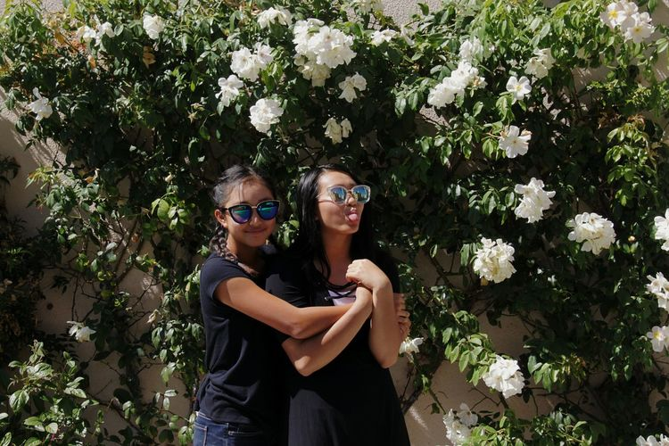 Two Is Better Than One Flower Plant Freshness Person Nature Day Beauty In Nature In Bloom Botanical Garden Laughing Sunglasses Young Women People And Places