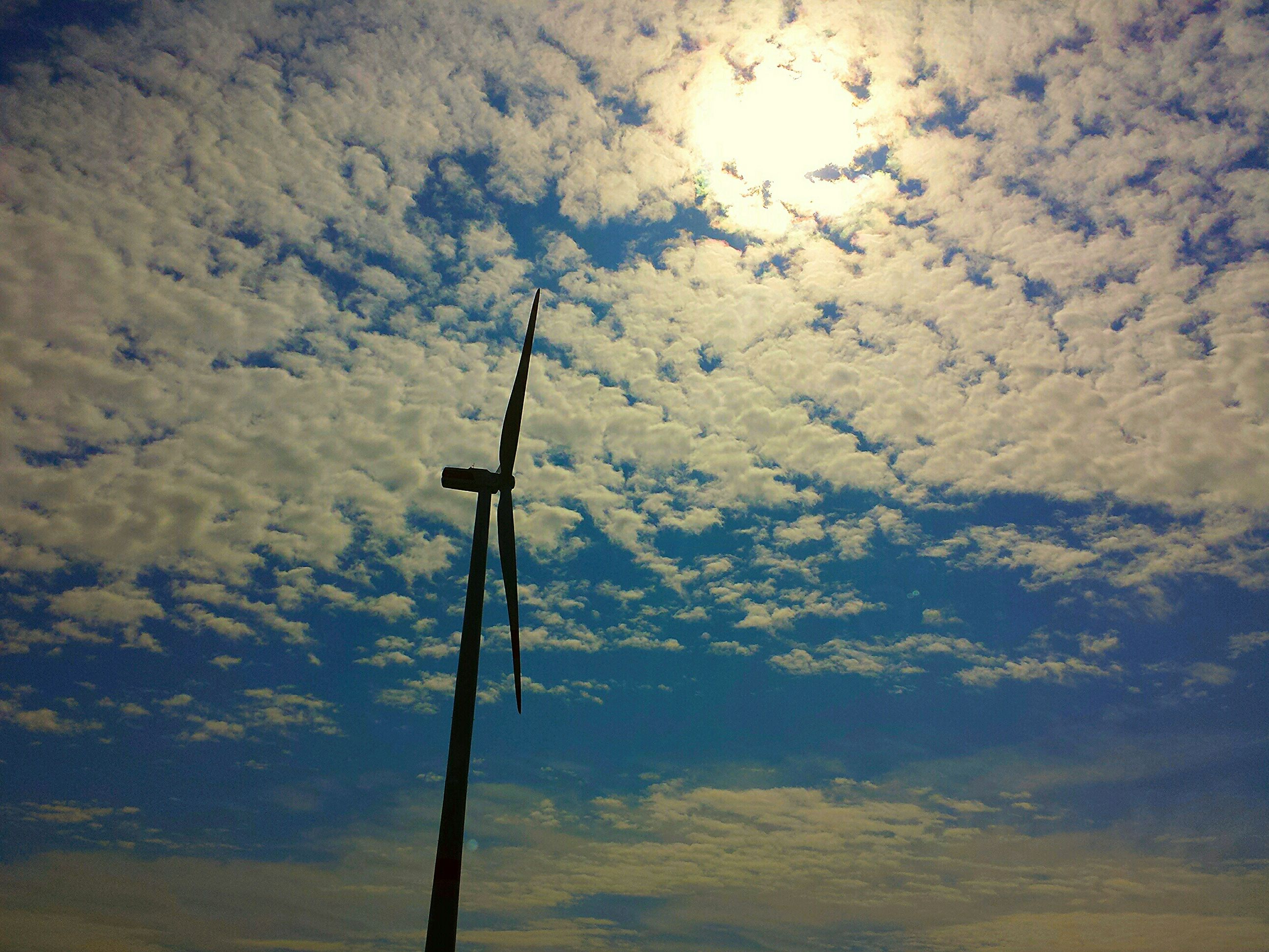 low angle view, sky, fuel and power generation, cloud - sky, wind power, tranquility, wind turbine, environmental conservation, nature, lighting equipment, cross, alternative energy, renewable energy, windmill, pole, street light, tranquil scene, technology, no people, cloud