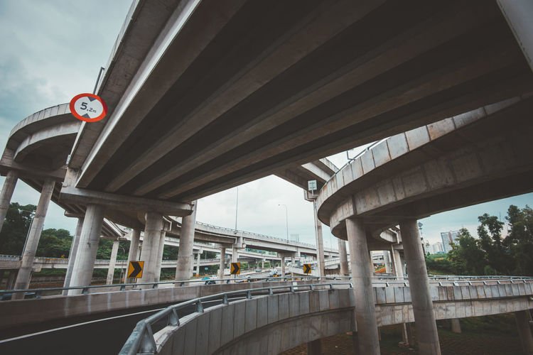 Architectural Column Architecture Bridge Bridge - Man Made Structure Building Exterior Built Structure Communication Connection Day Elevated Road Low Angle View Nature No People Overpass Public Transportation Rail Transportation Road Road Sign Sign Sky Transportation