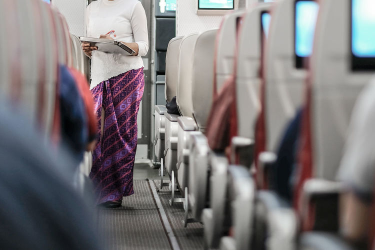 On The Way Batik Hospitality Cabin Crew Holiday Air Vehicle Airplane Business Clothing Commercial Airplane In A Row Journey Lifestyles Passenger Selective Focus Transportation Travel