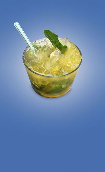 Close-up of drink against blue background