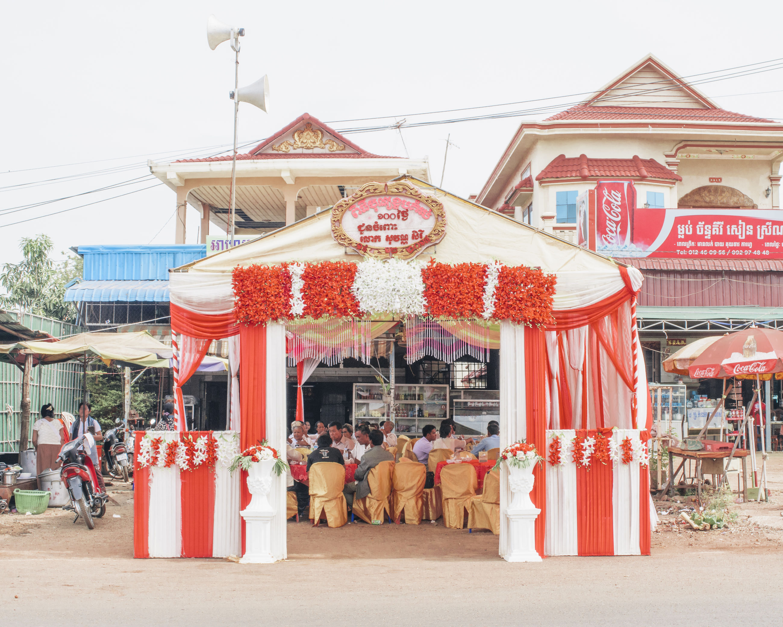 built structure, architecture, building exterior, tradition, religion, cultures, place of worship, spirituality, temple - building, culture, person, large group of people, market, clear sky, roof, day, market stall, multi colored
