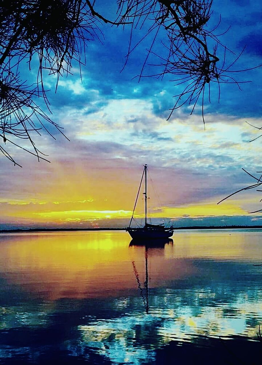 water, sea, sunset, sky, cloud - sky, scenics, nature, beauty in nature, tranquility, tranquil scene, silhouette, nautical vessel, transportation, reflection, outdoors, waterfront, horizon over water, mast, no people, beach, moored, tree, day
