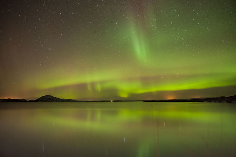 Aurora borealis - Lake myvatn - Iceland Beauty In Nature Scenics - Nature Night Tranquility Water Tranquil Scene Sky Lake Idyllic Green Color Star - Space Reflection No People Astronomy Nature Space Waterfront Non-urban Scene Star Aurora Polaris Iceland Aurora Borealis Northern Lights