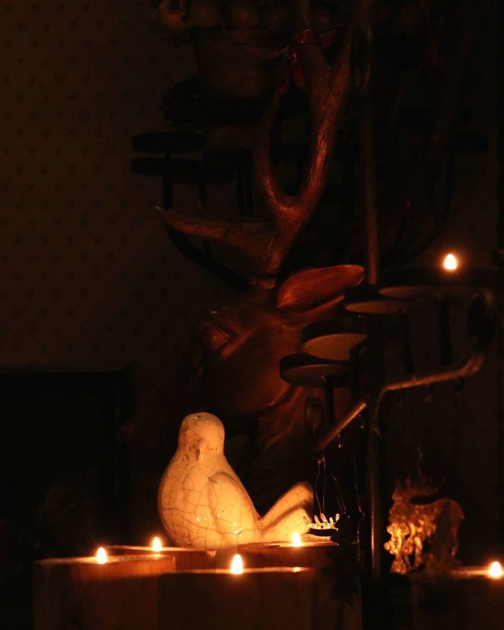 night, flame, burning, statue, illuminated, sculpture, indoors, heat - temperature, no people, christmas decoration, close-up, carousel
