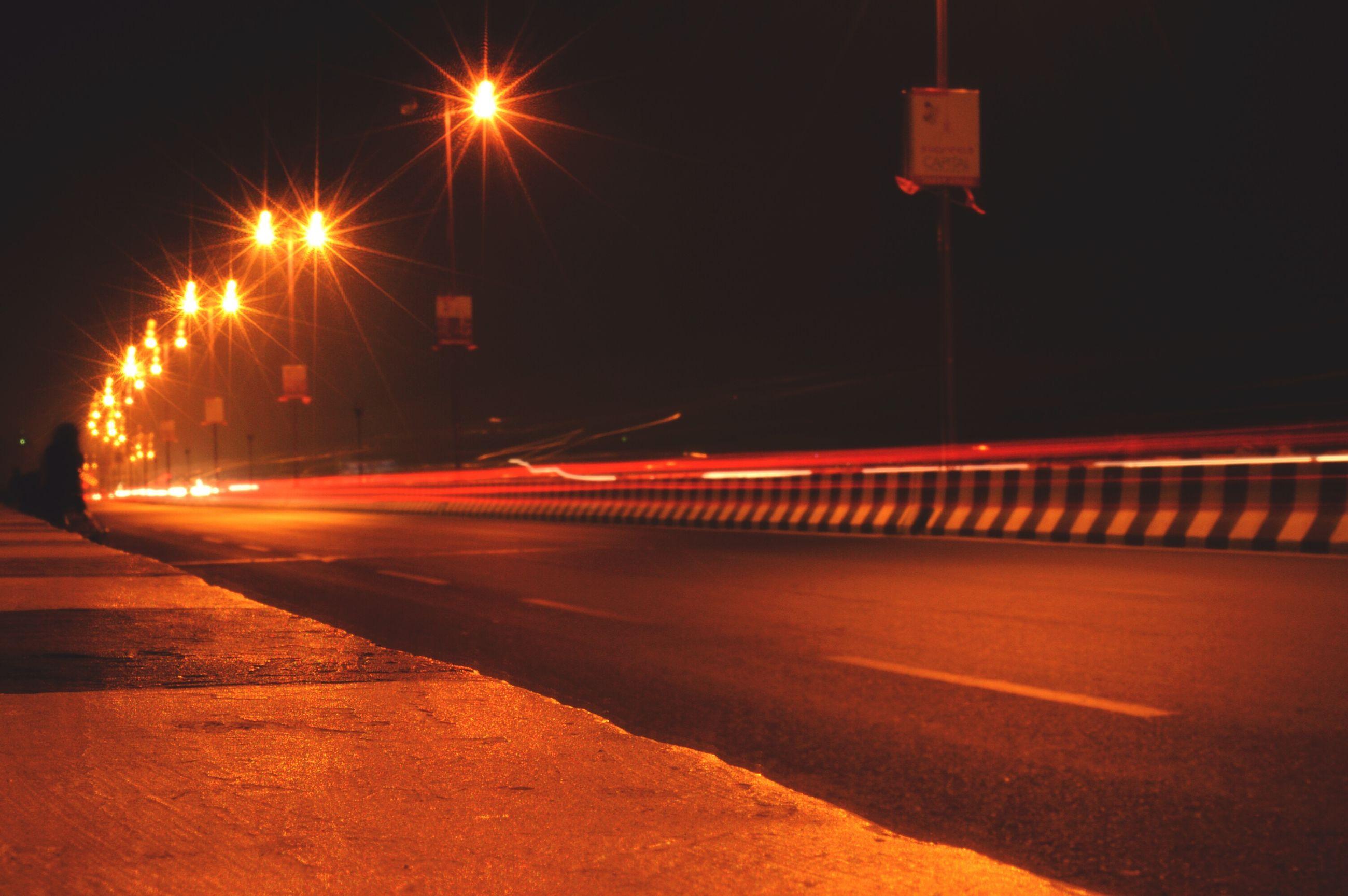 night, illuminated, long exposure, street light, no people, light trail, road, outdoors, architecture, high street, sky