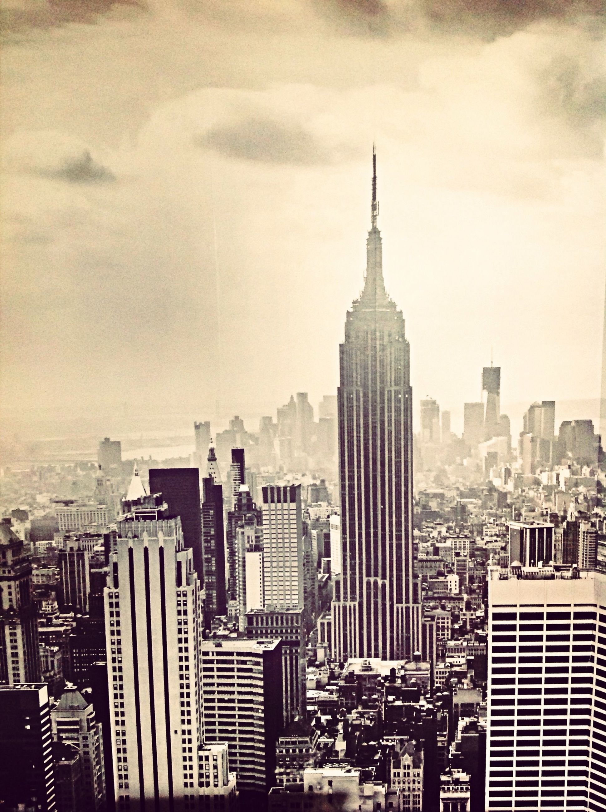 building exterior, architecture, city, skyscraper, built structure, tall - high, cityscape, tower, modern, office building, capital cities, sky, financial district, travel destinations, famous place, international landmark, crowded, empire state building, urban skyline, tourism