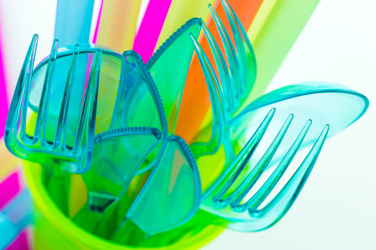Disposable tableware made of colorful plastic Disposable Fork Spoon Tableware Close Up Close-up Drinking Straw Environmental Protection Garbage Group Group Of Objects Indoors  Kitchenware No People Plastic Polluting Still Life Studio Shot Waste White Background