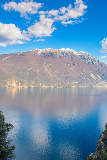 mountain reflected on the water Summer Wide Angle View Mountain Lake Water Lake Garda Reflection Color Colorful Peace Silence Mountain Reflection Cloud Reflections Sky Remote Outdoors Tranquility Tranquil Scene Idyllic Blue Sky