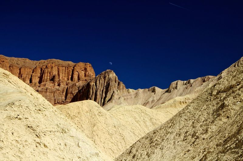 Lunar landmark Clear Sky Mountain Valley Desert Rocks Golden Death Valley Lunar Nature Blue Copy Space Geology Tranquility Beauty In Nature Scenics