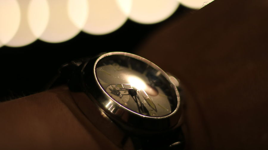 High angle view of illuminated clock on table