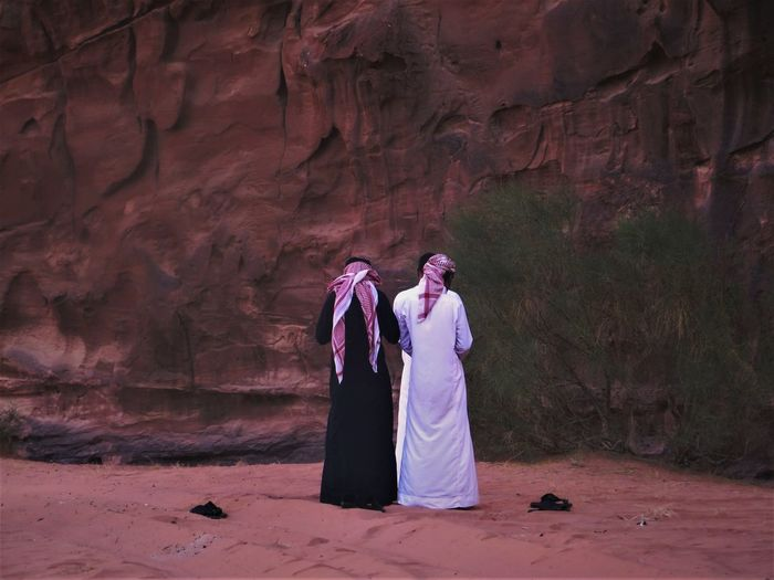 Jordan Desert Wadi Rum The Traveler - 2018 EyeEm Awards Adult Clothing Couple - Relationship Day Full Length Lifestyles Love Men Nature Outdoors People Real People Rear View Rock Rock - Object Rock Formation Solid Standing Traditional Clothing Two People Women