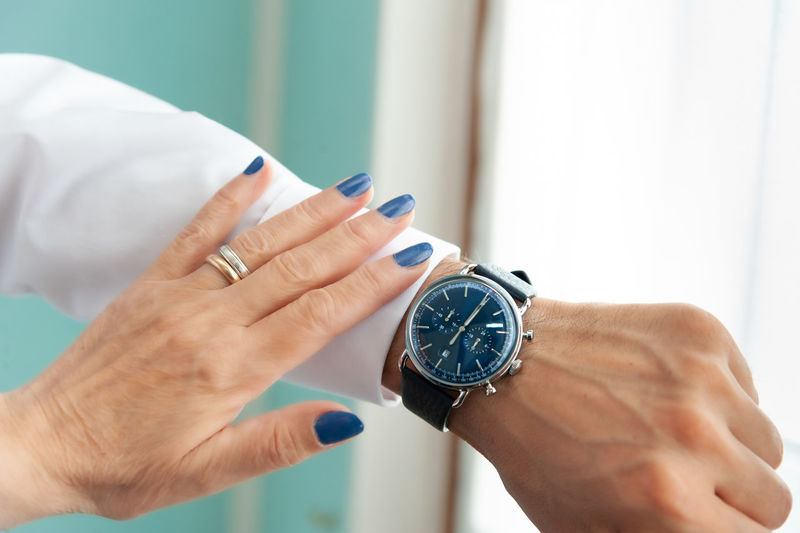 Human Hand Hand Time Watch Human Body Part Wristwatch Real People Indoors  People Adult Body Part Clock Men Focus On Foreground Holding Instrument Of Time Finger Human Finger Lifestyles Personal Accessory Human Limb Checking The Time