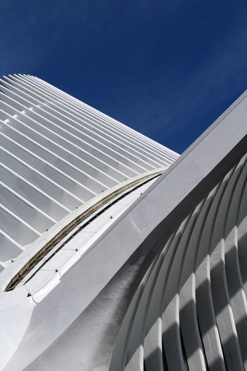 Architecture Blue Building Building Exterior Built Structure Ceiling Clear Sky Day Low Angle View Metal Mode Of Transportation Modern Nature No People Office Building Exterior Outdoors Pattern Silver Colored Sky Sunlight Transportation White Color