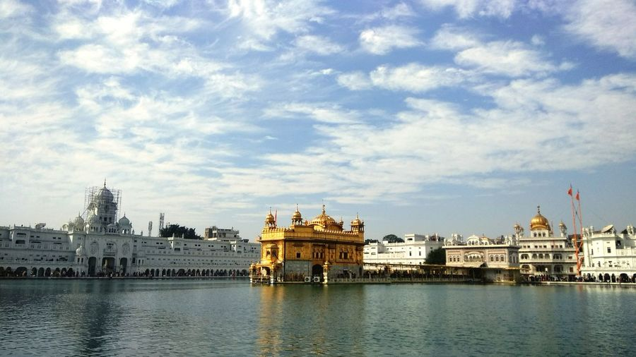 Golden temple against cloudy sky