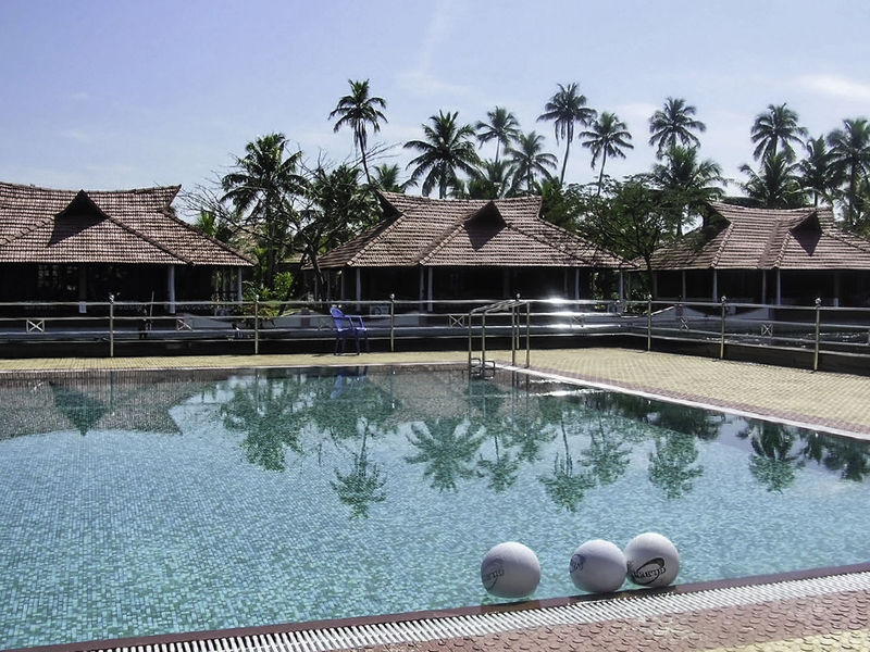 This is a beautiful resort, called Lake View Palace, located in Alleppey in the state of Kerala in India, located on the edge of a huge salty backwater lagoon, and inside the resort, you have this small swimming people with a beautiful blue color water. There are a couple of balls in the pool and these cottages with palm trees next to them. Alleppey Balls Balls In Pool Built Structure Hotel India Kerala No People Outdoors Palm Tree Pool Pool In Resort Sky Swimming Pool Tourist Resort Tree Tropical Climate Water