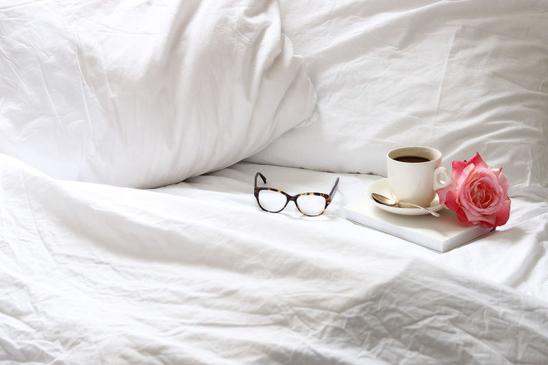 Morning coffee Bed Bedroom Book Clean Close-up Coffee Fresh Indoors  Morning Light No People Pillow Quiet Time Reading Relaxation Relaxing Rest Romance Roses Sheet Sheets White White Color