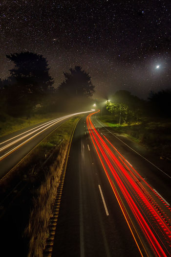 Traffic on Hwy 101 under the stars and moon. California Moon Night Photography Astronomy Blurred Motion Clear Sky Galaxy Illuminated Light Trail Long Exposure Motion Nature Night No People Outdoors Road Scenics Sky Space Speed Star - Space Star Trail Stars The Way Forward Transportation