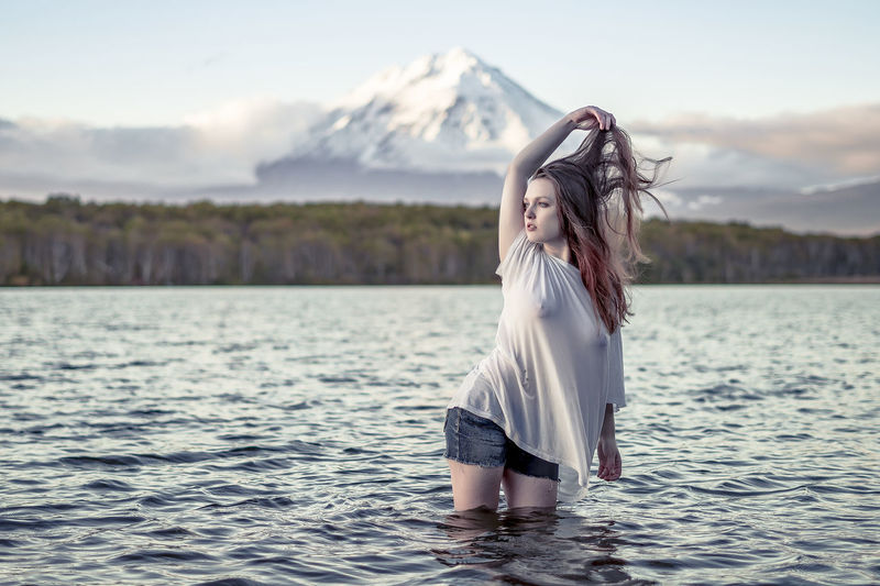 Arms Raised Beautiful Woman Beauty In Nature Fashion Hair Hairstyle Human Arm Leisure Activity Long Hair Mountain Nature One Person Outdoors Scenics - Nature Sky Standing Tranquility Water Waterfront Women Young Adult Young Women