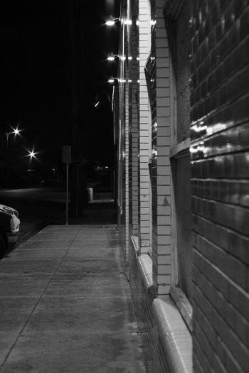 the wall Minolta50mmf2 PentaxK70 Blackandwhite Art City Illuminated Architecture Building Exterior Built Structure Street Light Empty Road The Way Forward Lamp Post Asphalt Pathway vanishing point
