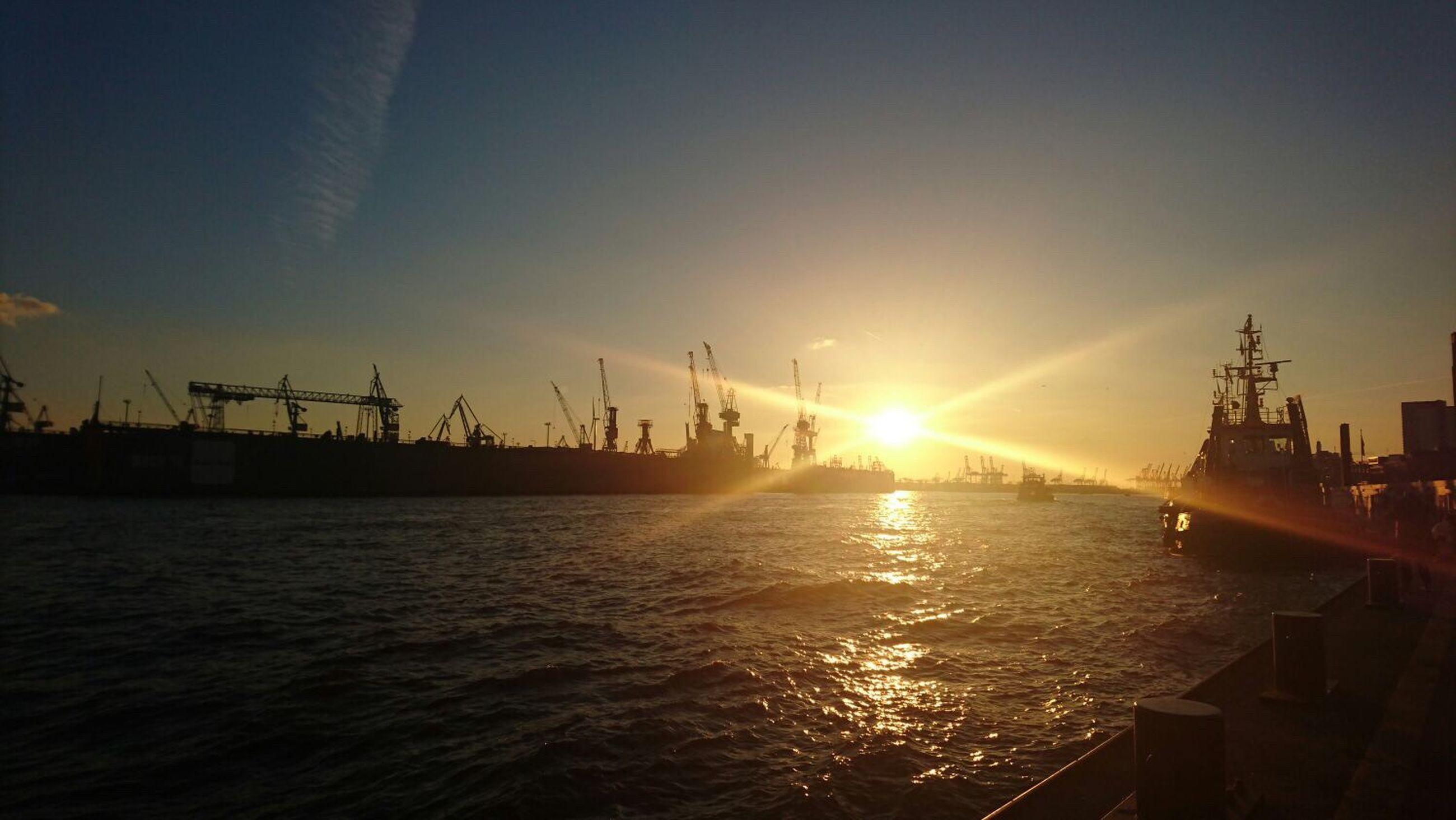 sun, sunset, water, crane - construction machinery, commercial dock, crane, harbor, sunlight, sky, fuel and power generation, industry, sunbeam, waterfront, silhouette, built structure, sea, alternative energy, nautical vessel, renewable energy, development